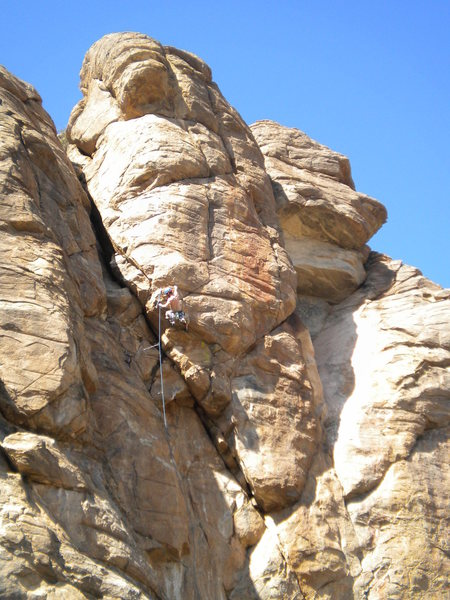 David Merin beginning the traverse across the horizontal crack - leaving Hashbrowns and entering the business on Flame Out. <br> <br> Photo by Eric Rhicard