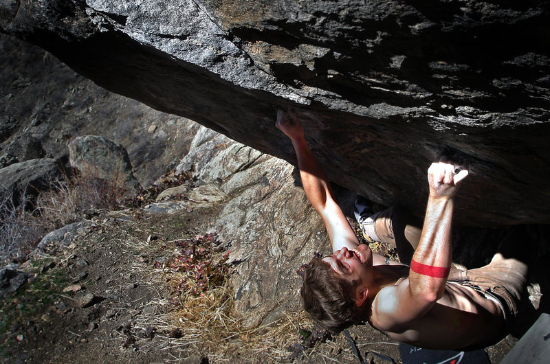 "Jason Baker standing up to the explosive power of ""Rhino (v10).""<br> <br> Photo by: Luke Childers"