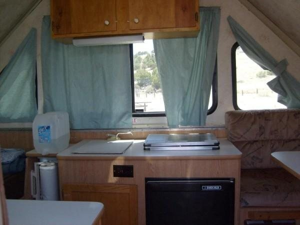 includes fridge, heater, sink, outlet for inverter, water tank.