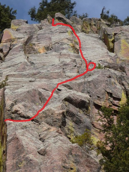 Red line shows the route from the traverse at the horn on the first pitch to the top.  First belay is circled.