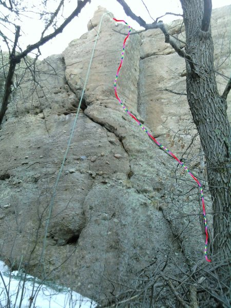 Up the outside corner, staying mostly on the left of the arete.  The Honey Crack is obvious to the left of this climb.