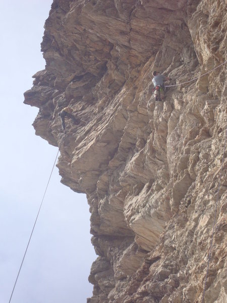 I am belaying from a pair of rap bolts at the top of Vitamine P.  David Hodges is cleaning the draws.