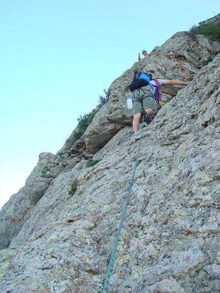 Phil Ermshar climbing brittle class 4 rock near the top of pitch 3. Photo by Cheri Ermshar.