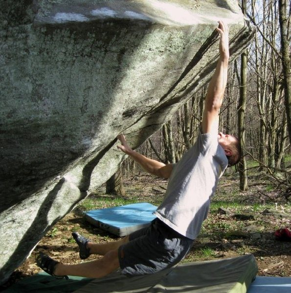 "Shane Messer dynoing to the lip on ""O.A."" (V-7) on the cap-gun boulder"