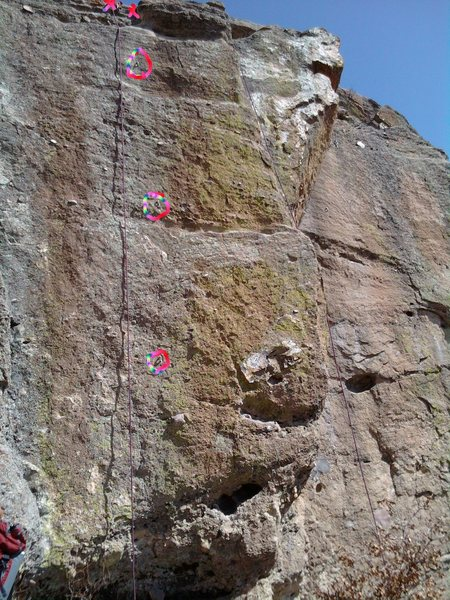 Genghis Khan is the 3 bolt line up to the anchors.  Kublai Khan is the narrow climb to the right (left hand clips), avoiding the arete.