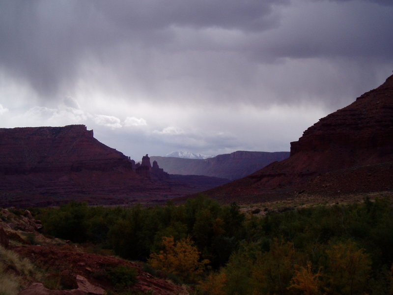 Fisher towers, clouds, La Sal mountains in back
