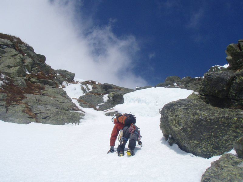 Peeking around a corner to check out an ice bulge high in Yale Gully.<br> <br> Photo by Courtney Ley.