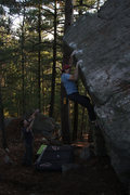 Rock Climbing Photo: In the middle of the problem, getting ready for an...