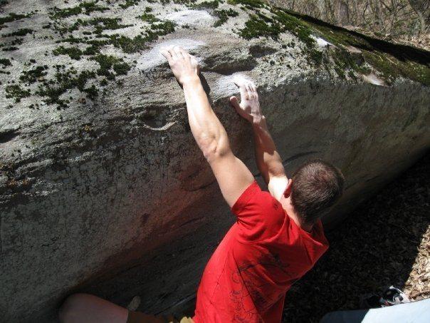 """Shane Messer on """"Smooth Criminal"""" (V-7) on the Criminal Boulder. Left Boneyard"""