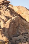 Rock Climbing Photo: Climber finishing up Raked Over the Coles, 5.10+