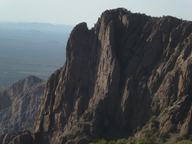 Does anyone know anything about these spectacular towers, if there are any routes on them or if it is even legal to climb on them?  They are not that far above Baboquivari camp.