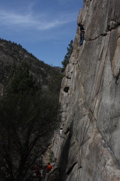 Looking at the thin seam right after the crux.