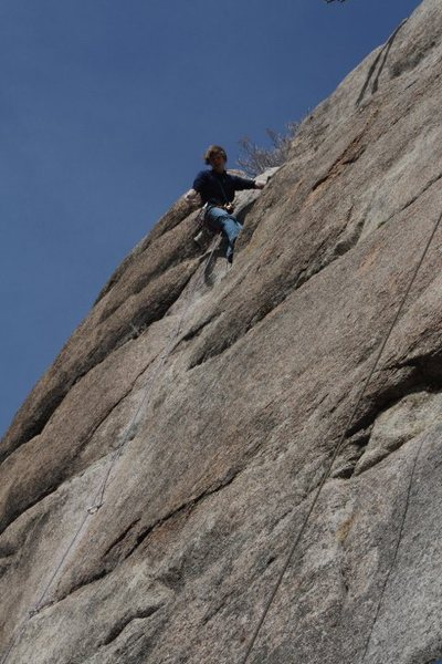 Toping out on an onsight ascent.
