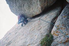 Rock Climbing Photo: Feet set high to pull up to move around the corner