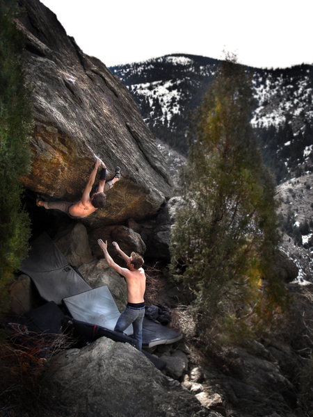 Jason Baker squeezing and pulling to gain the final exit (crux) moves on &quot;Stanley Kubrick (V11).&quot; <br> <br> Spotter:  Tom<br> <br> Photo by:  Luke Childers