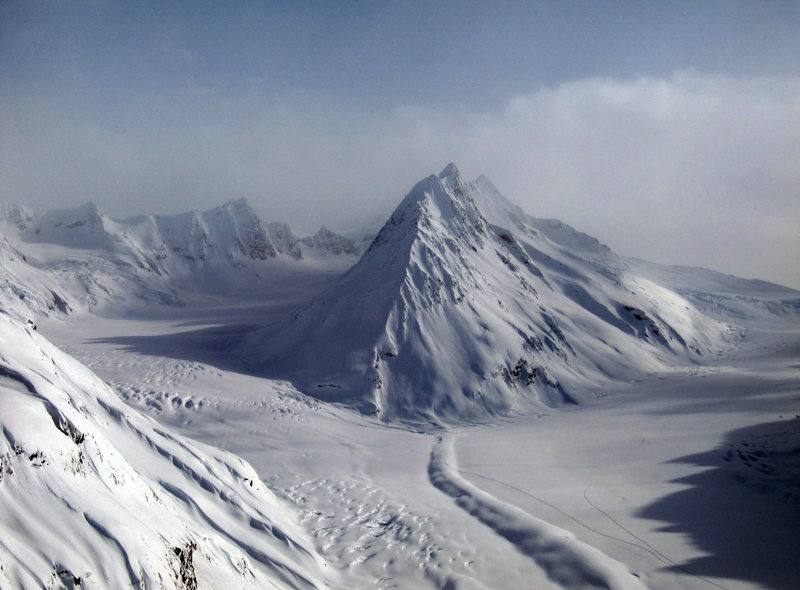"""This Peak is called the """"Island"""".  Deep in the Chugach range.  We skied the shadowed wall to the left of the prominent spine.  45-50 degrees for 3000 vertical!"""