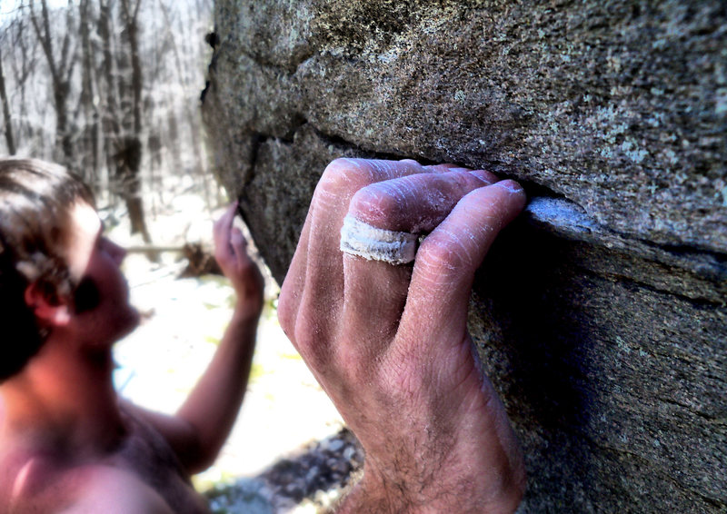 "Steve Lovelace feeling out the grim crimp sequence on the ""Midnight Reverie Traverse"" project..."
