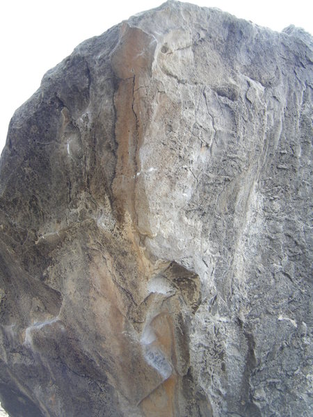 Rock Climbing Photo: The second half of the problem moves up the arete....