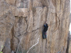 Rock Climbing Photo: Placing gear on the upper part of the seam.