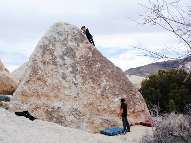 Climbing on Wedge Boulder, 'Right Arete' V0- in Joshua Tree. Nice little warm up.