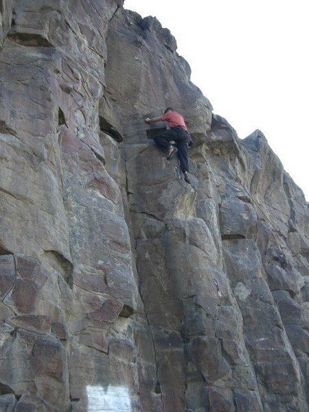 Ryan Flynn working a route at the Black Cliffs