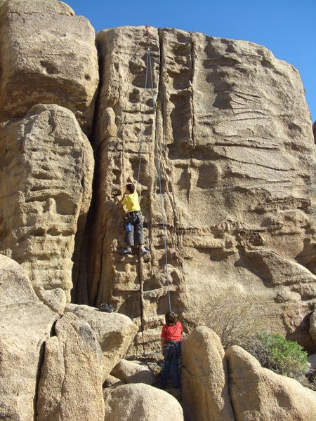 Mitch Boreing(age 12)and my son Carlo trying to work out Jim Cruise on TR, Zebra Cliffs, North Face.