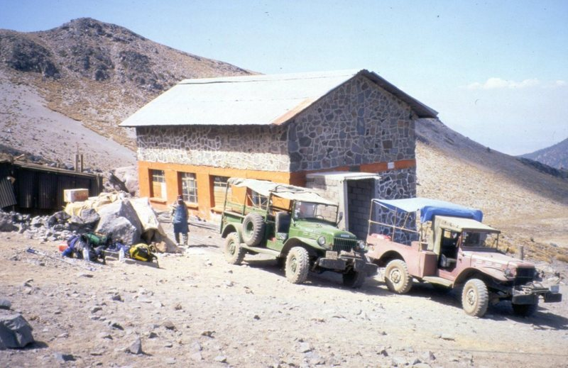 Dodge Power Wagons in front of the large hut at Piedre Grande.