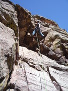 Rock Climbing Photo: Hanging out at the overhang. Photo: Roth