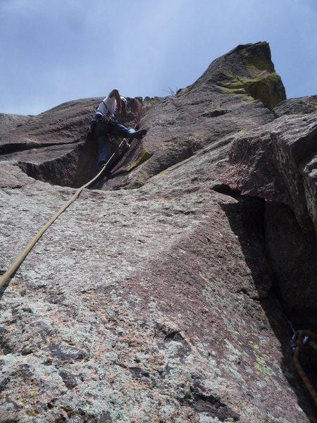 Placing gear in the crux corner.<br> Photo: Roth.