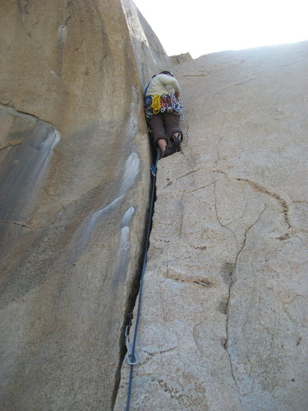 Agina getting a little Trad lead practice on The Jam Crack (Smooth Sole Wall).  4-18-10