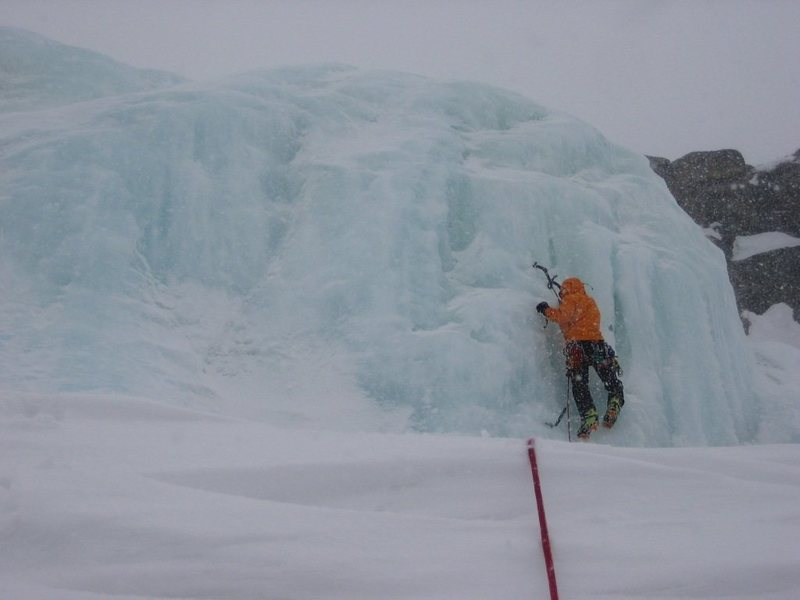 Joe Brannan starting up the lower step.  The first few meters of ice is hidden by the snowdrift. 4-17-10.