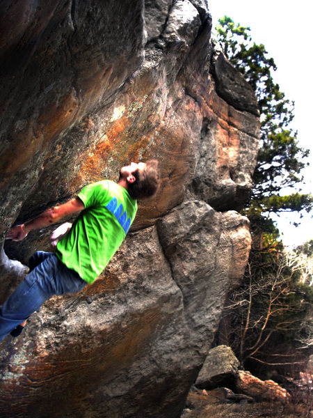 "Tom pushing for the mega toss and stick on ""Zion (V8?).""<br> <br> Photo by:  Luke Childers."