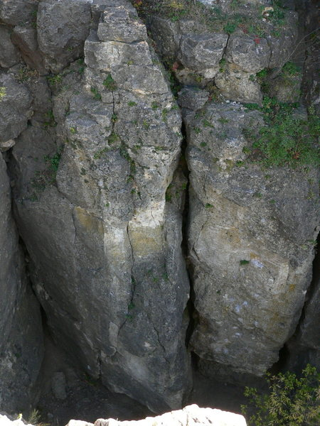 good view of Sentinel area.  Starting from the large crack on the left which is 3rd crack (5.7), you can see graduation day (5.12, pretzel face (5.9),Son of Godzilla (5.11), Nosey (5.6), Second crack (5.5), Blank Wall (5.10), and ending with 1st crack (5.6)