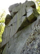 Wall immediately below The Pinnacle facing the road (NE).  The line  with the crack and two old pins is Stripes (5.10a?)  A TR can be placed using gear.