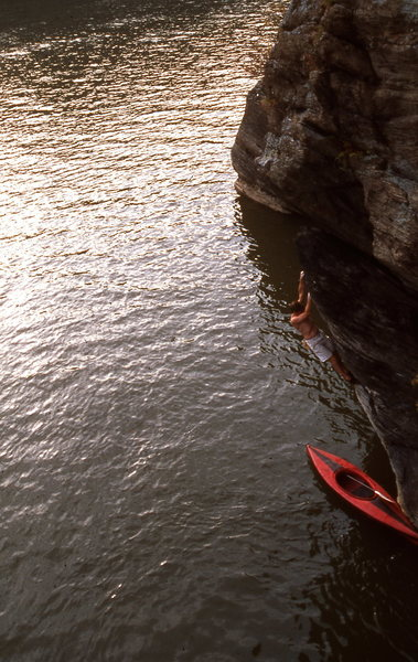 Susquehanna River, Muddy Run, Pennsylvania.  Deep water soloing.  50 feet of overhanging water-worn schist or limestone.