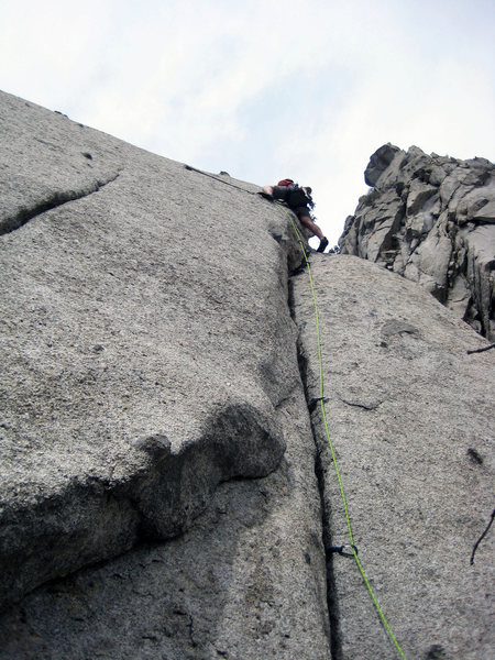 First Ascent with Shingo pulling the slab rockover with just a slung chicken head to protect the move.