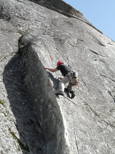 The first crux is mantling at the first bolt.