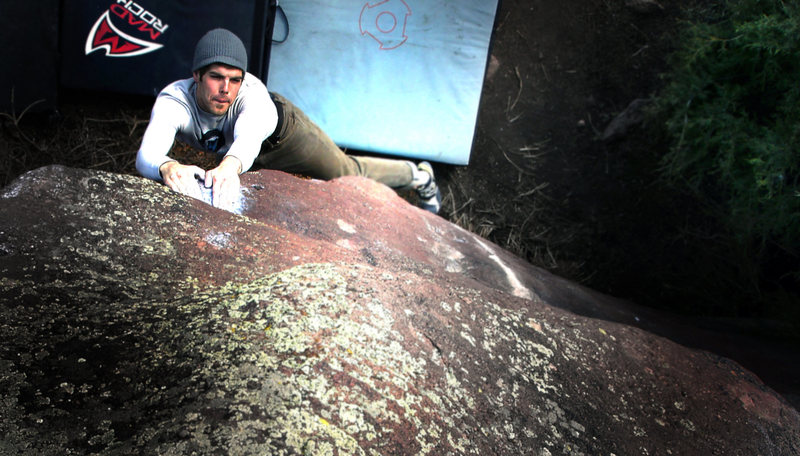 Jason Baker on &quot;Epiphany, V5/6.&quot;  Millennium Boulder, Colorado.<br> <br> Photo by:  Luke Childers.