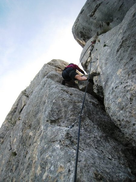 The p girl climbs back up to the last up climb on the traverse of Les Trois Pucelle
