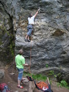 Rock Climbing Photo: James placing the first draw on Lies and Propagand...