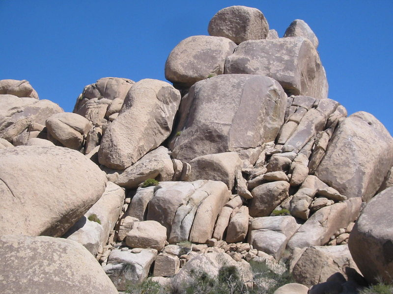 The Milk Arete ascends the face on the right buttess of rock in this photo. The blunt arete is the line between the lighter spotted rock and the dark rock on the right.
