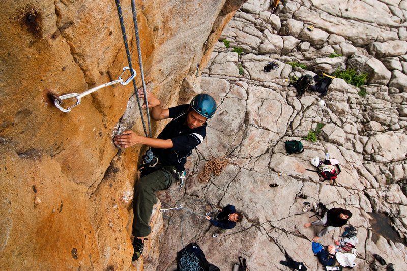 Rock Climbing Photo: A climber cleaning the Middle Route above the crow...