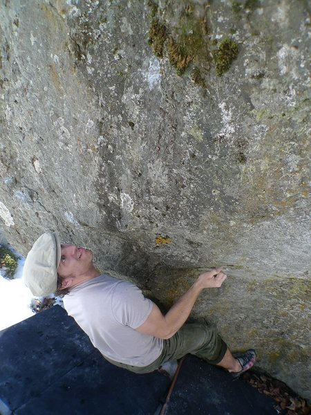 Todd Helgeson gearing up on the crux of The Driven Snow V8/9.