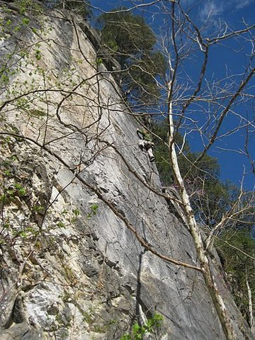 Greg Sudlow high on Unnamed RB 1 (5.11 b/c). Belay by Evan Kennedy. Photo by Josh Davidson.
