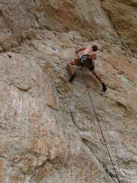 Leaving Killer and moving right through the lower 5.12'ish crux.<br> Photo by J. Dias