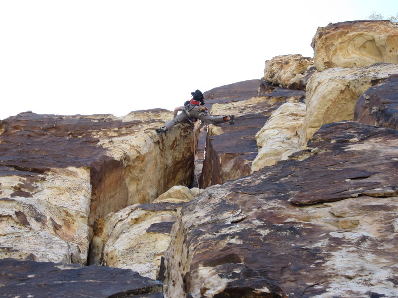 Rock Climbing Photo: S. Giffin stems up the wide section on pitch 5.  A...