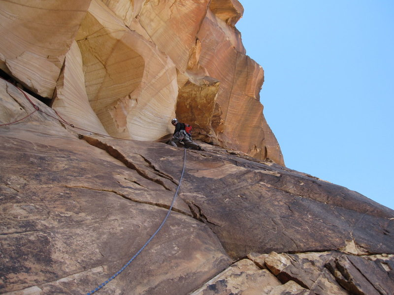 S. Giffin traverses out the roof on pitch 4.  Best pitch on the climb if combined with pitch 5.