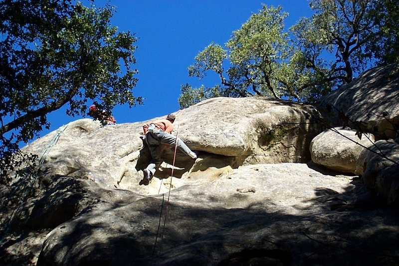 Paul doing the crux move thru the roof of Putrefaction.  November 2004