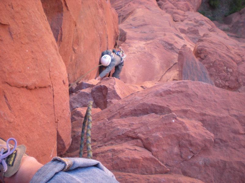 Dan Millis is beginning the climb's overhanging crux on P2.