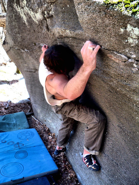 "Steve Lovelace cranking hard to get the FA of ""Reverie"" (V-6) on the Reverie Block, Boneyard Area, GHSP."